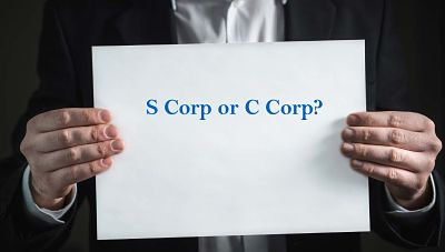 sign that says S Corp versus C Corp, Gilmore Jasion Mahler