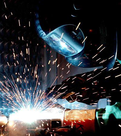 Welder with sparks flying